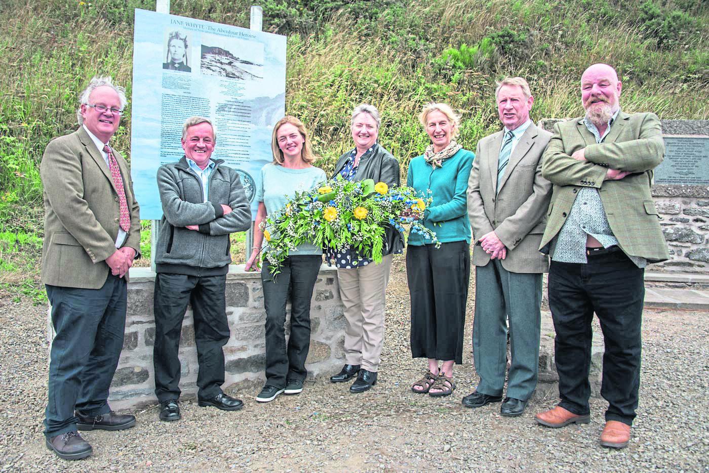 Bill Pitt, Wilson Irvine, Wendy Andrews, Miriam Kemp, Leanda Denton, Gordon Duguid, Robbie Kelman alongside the new information board.