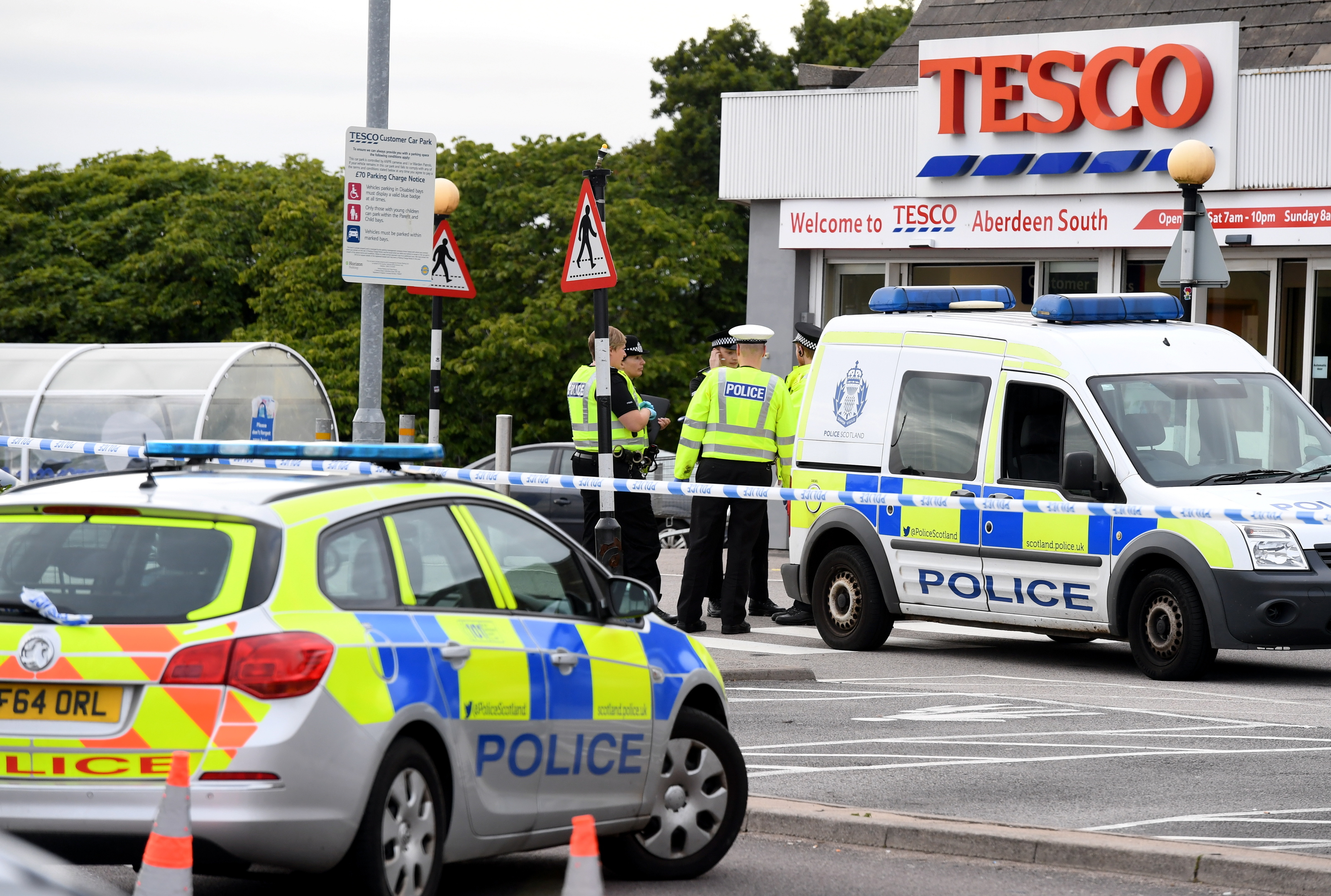 Officers from Police Scotland at Tesco, Wellington Road, Torry, where a pedestrian was knocked down.     Picture by Kami Thomson    13-08-18