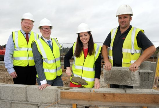 Kate Forbes MSP and Housing Minister Kevin Stewart visited the affordable homes project in Kyleakin last August - which has just been completed
