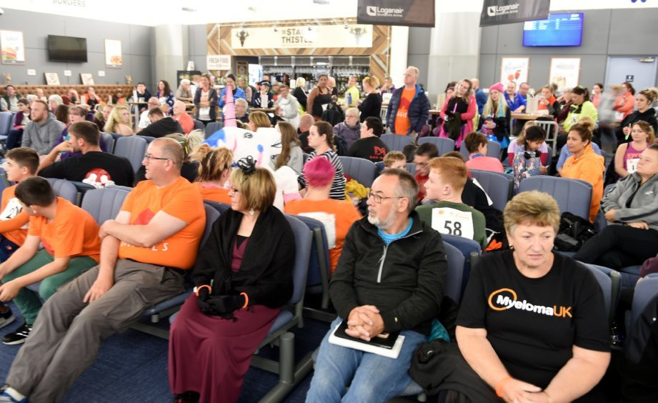 Participants are given their safety briefing in the departures lounge.