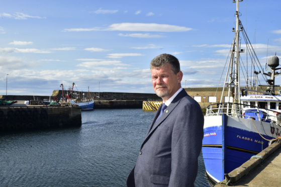 Councillor Ross Cassie at Macduff Harbour.