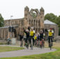 Ride the North cyclists passing Elgin Cathedral.