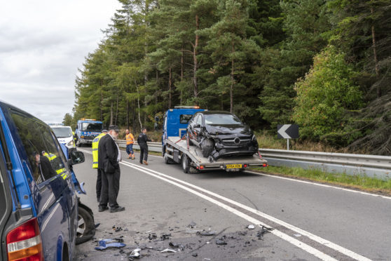 This is the scene of a RTC involving a Black Mercedes Car and a Blue VW Mini Bus on the A95 approx 1 mile west of the junction with the A96 at Keith. The Mercedes would have been travelling West and the VW Mini Bus would have been travelling East, returning to Keith, having dropped off all its School Pupils. The accident happened on a series of bends with distinct no overtaking centre lines.