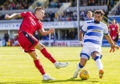 Ross County's Josh Mullin is challenged by Morton's Rory McKeown.