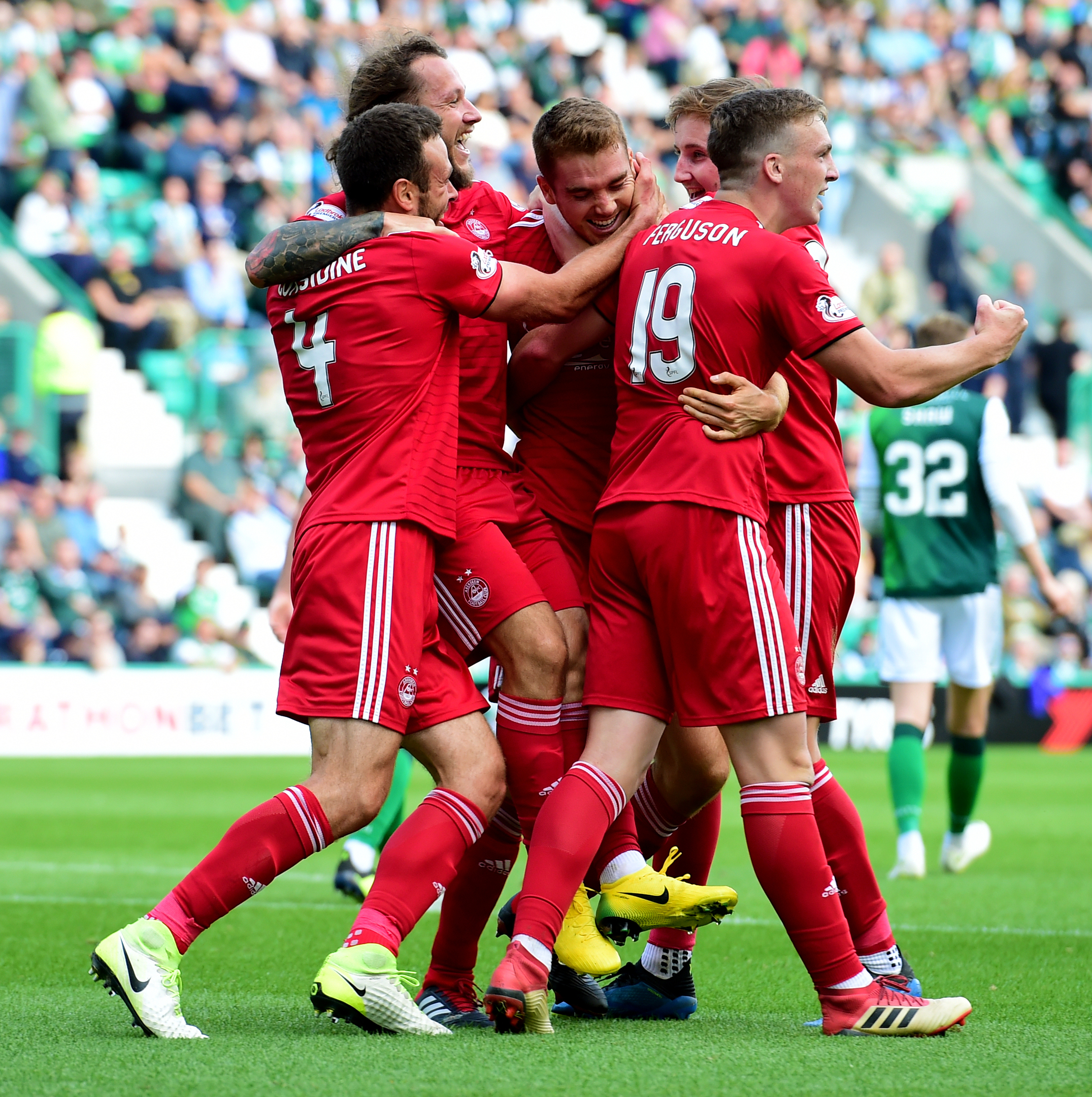 Tommie Hoban is congratulated after bagging his first goal for Aberdeen.