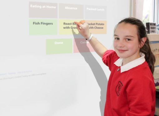 Grace Rennie, P6 pupil at West End Primary School, places her lunch order.