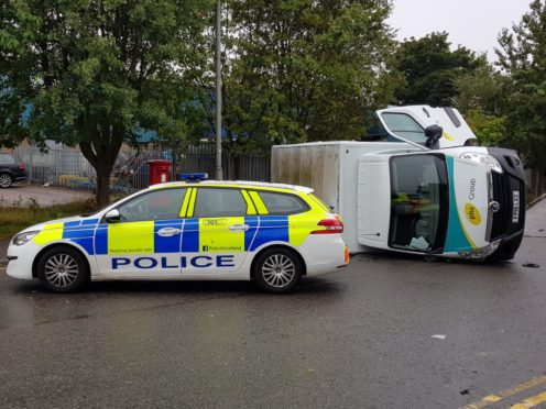A van was left on its side after the two-vehicle crash on Greenbank Road.