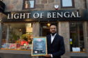Pictured is Noor Ahmed with his award at the Light of Bengal, Rose Street, Aberdeen. Light of Bengal has picked up the first prize in Manchester at the Asian Curry Awards – 'Best Restaurant In Scotland'. It is also the restaurant's 40th anniversary this year.  Picture by DARRELL BENNS     Pictured on 09/03/2018
