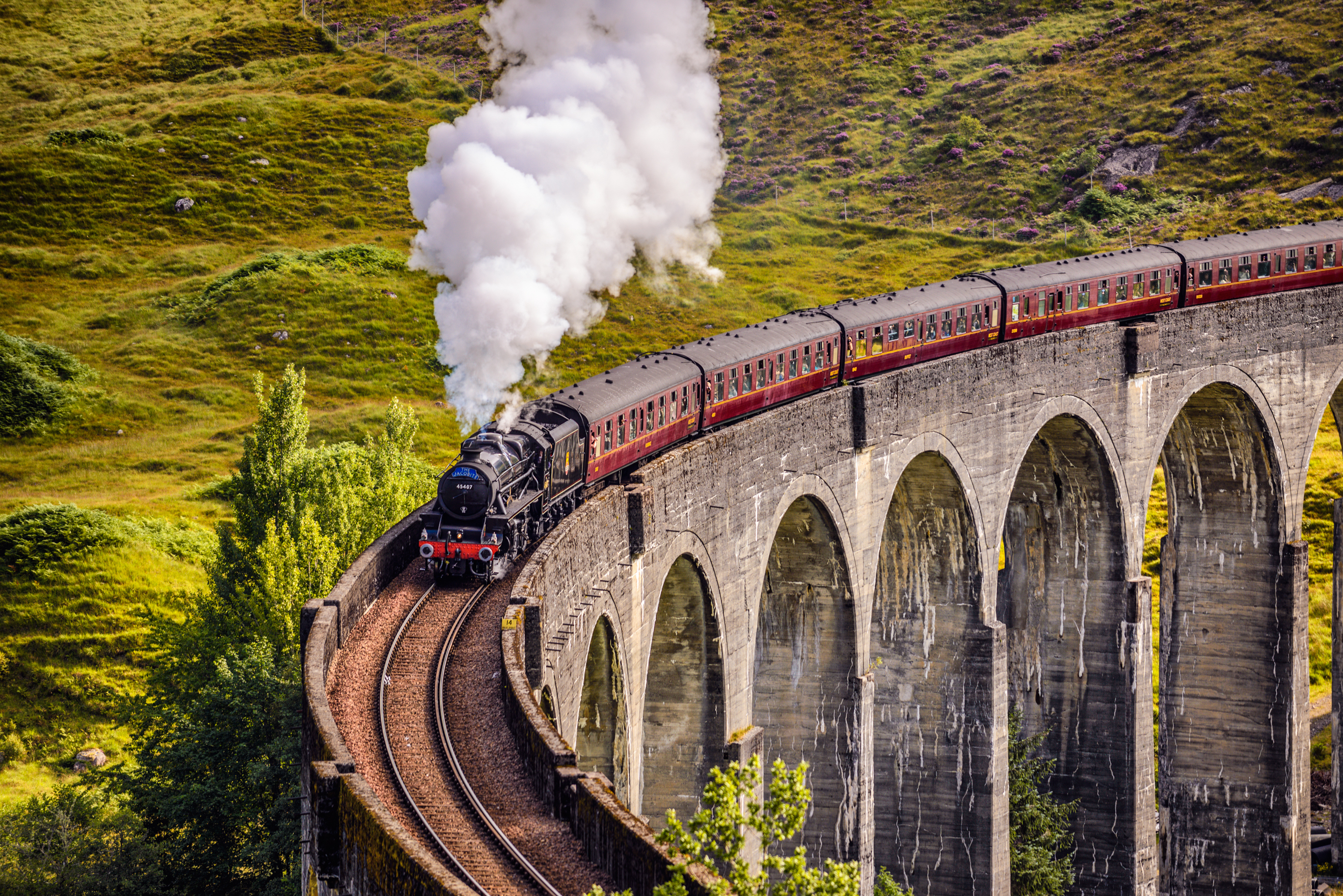 The Glenfinnan viaduct with the Jacobite steam train passing over.