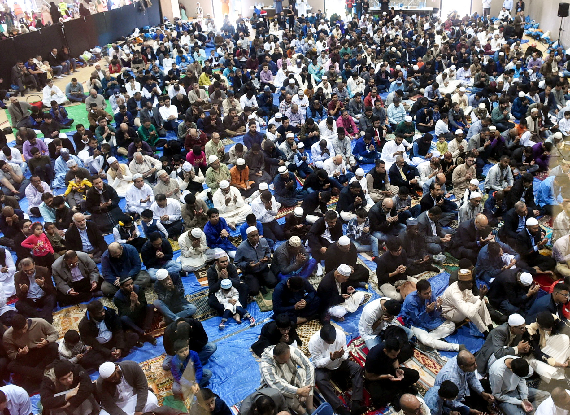 The Aberdeen Mosque and Islamic centre, celebrate the Eid in the Garden at Aberdeen Leisure centre, Aberdeen. In the picture they are at prayer.  Picture by Jim Irvine.