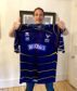 Gary Innes proudly holds Runrig signed shirt