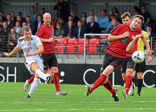Picture of Niall Docherty having a shot at goals. Picture by Kenny Elrick.