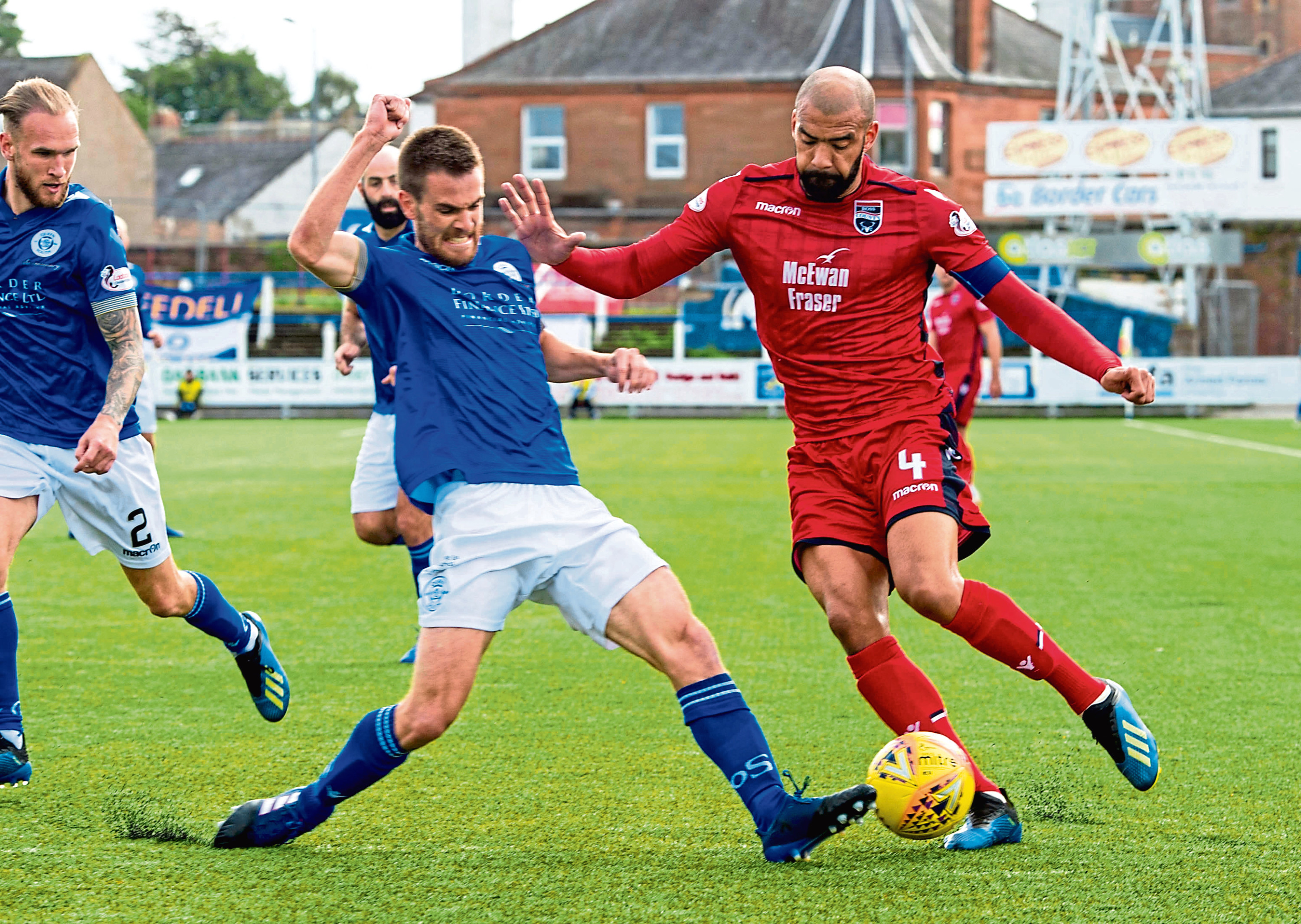 15/09/18 LADBROKES CHAMPIONSHIP   QOTS v ROSS COUNTY (0-0)   PALMERSTON PARK - DUMFRIES   Ross County's Liam Fontaine (right) holds off QOTS' Kyle Jacobs