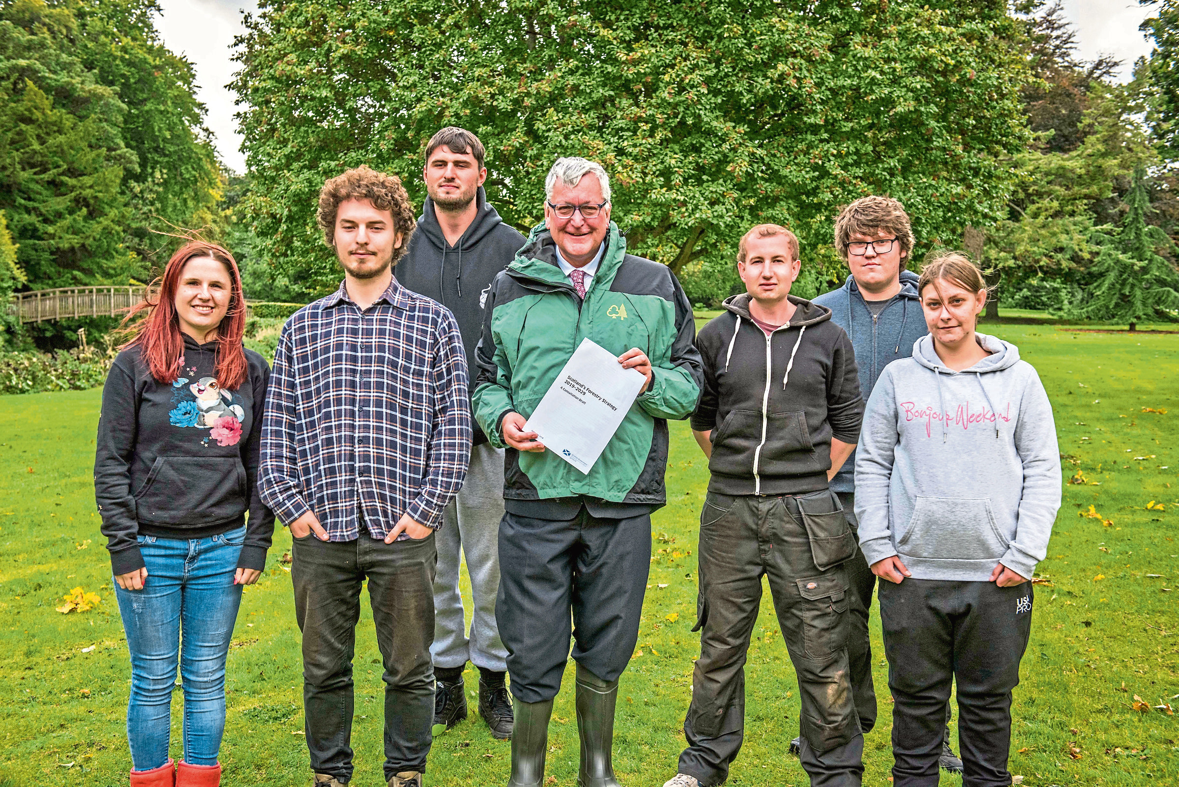 Cabinet Secretary Fergus Ewing (centre with document) with Newbattle Abbey College students.