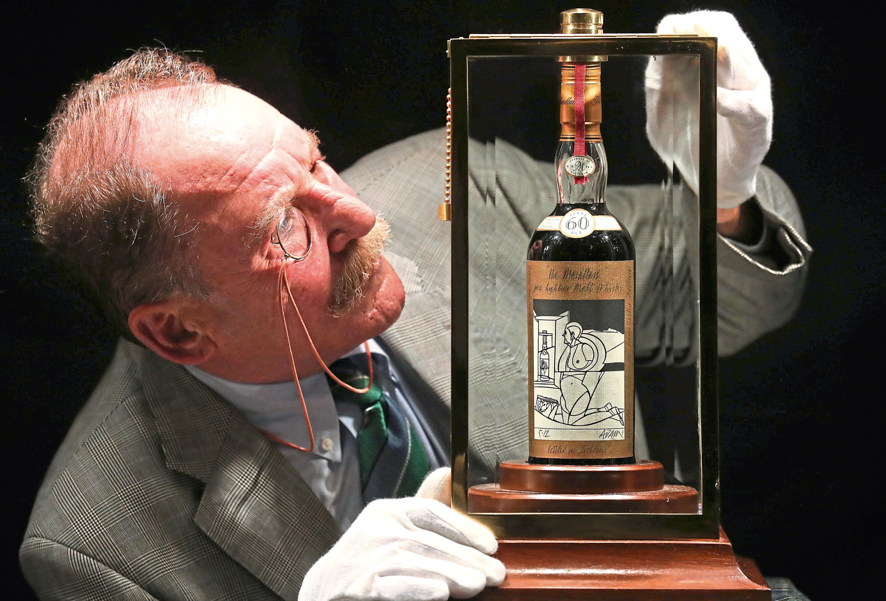 Whisky expert Charles MacLean with the worlds rarest and most valuable whisky