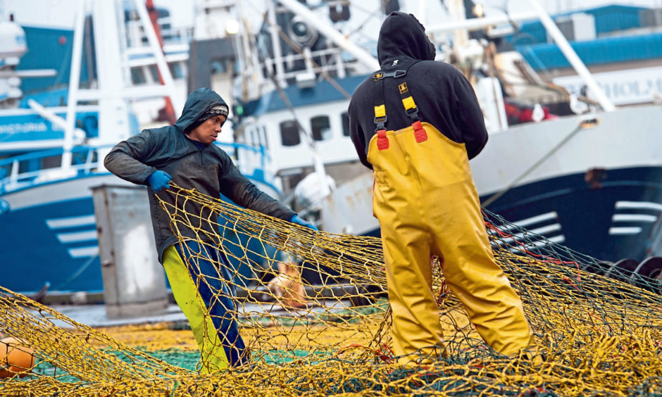 Fishermen at Peterhead harbour. Local crews will be watching the trade negotiations with keen interest.