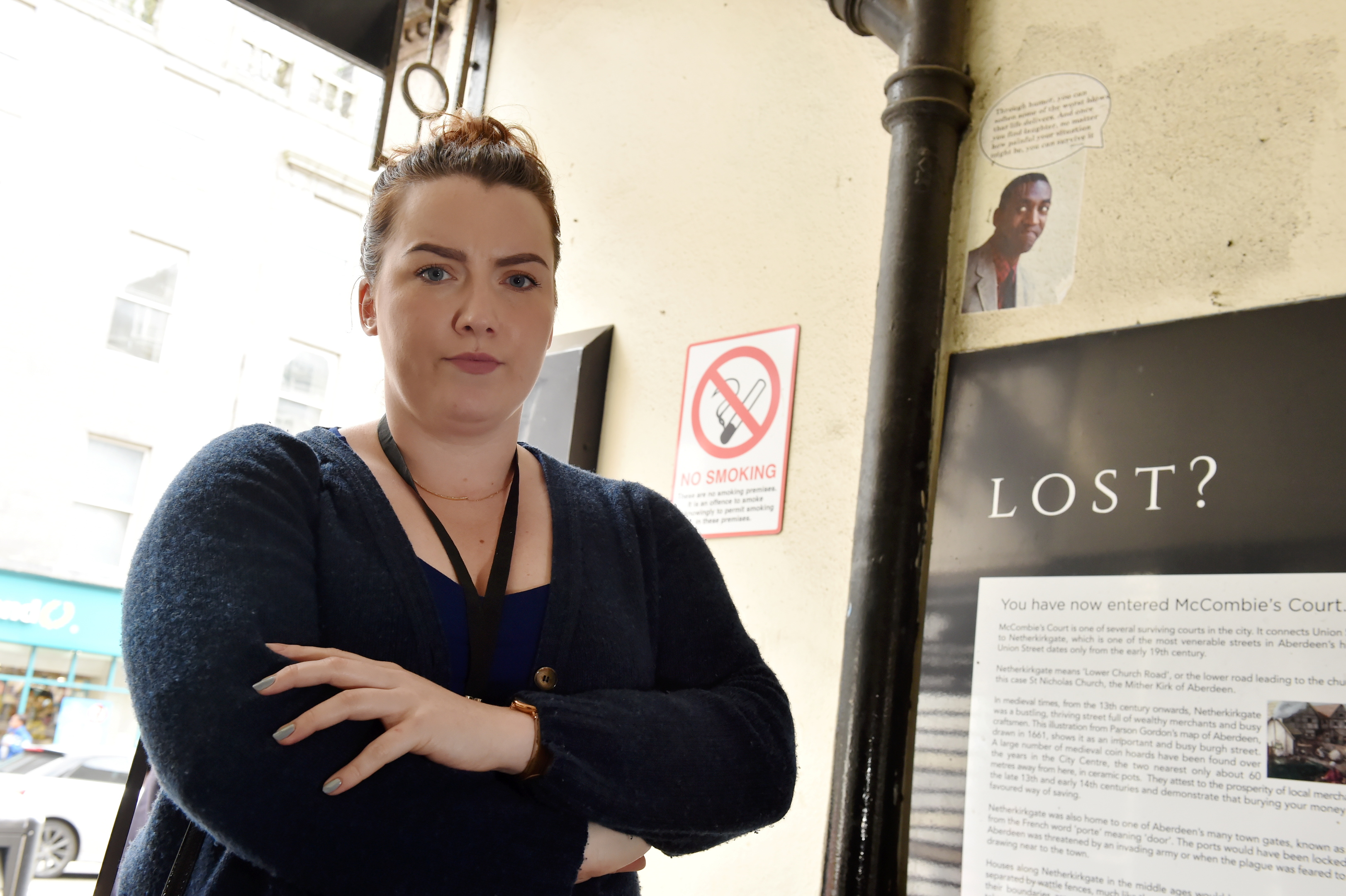 Councillor Catriona Mackenzie with the graffiti, which has since been removed.