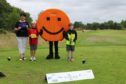 Sheena Anderson of AABi with Fletcher Riach and Riley Reid taking part in the Grass Roots golf programme at The Paul Lawrie Foundation.