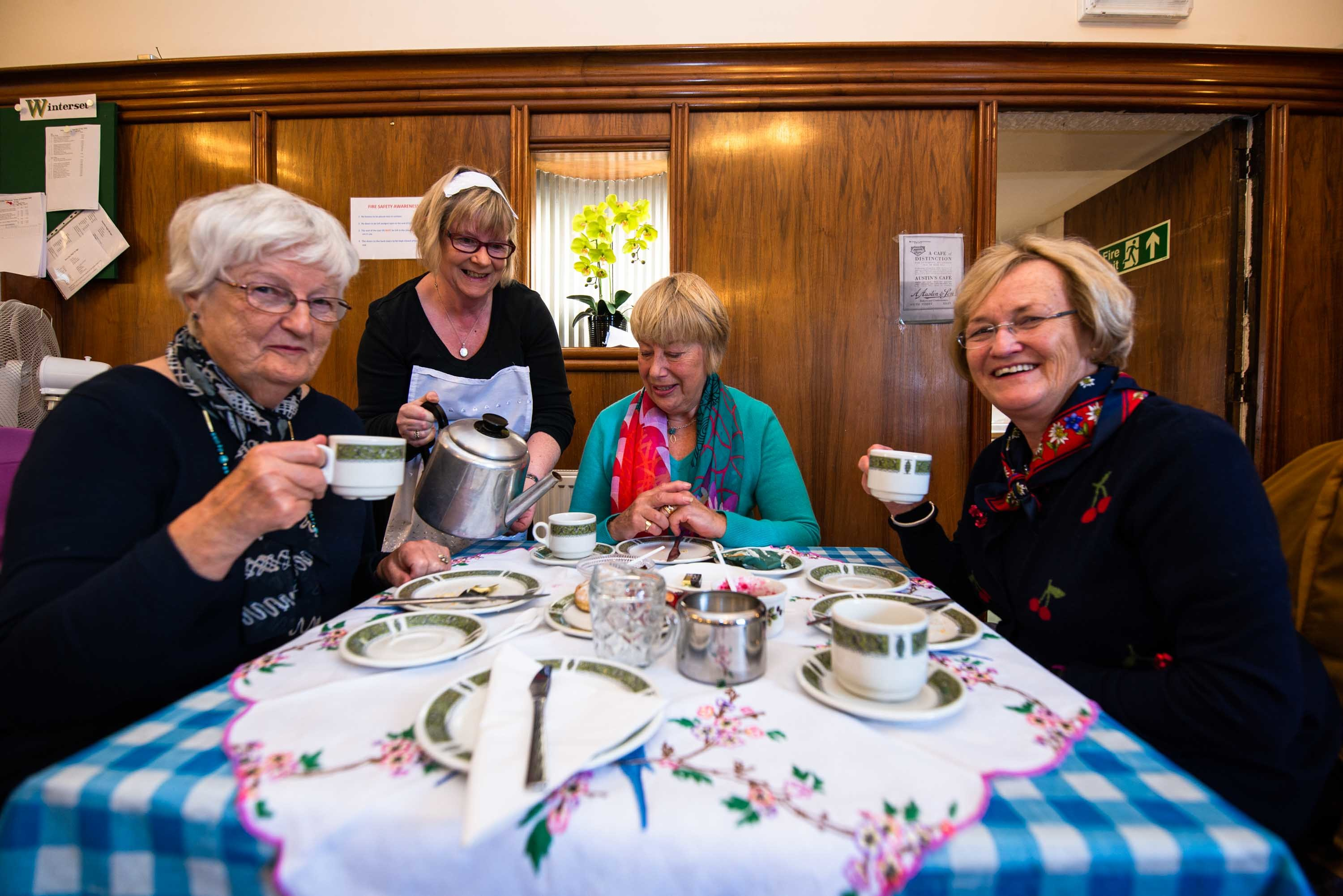 Volunteer Janice Mackenzie waits on the table of Anne Smith, Marjorie Adam and Catherine Fettes at the recreated Austin's Tea Room.