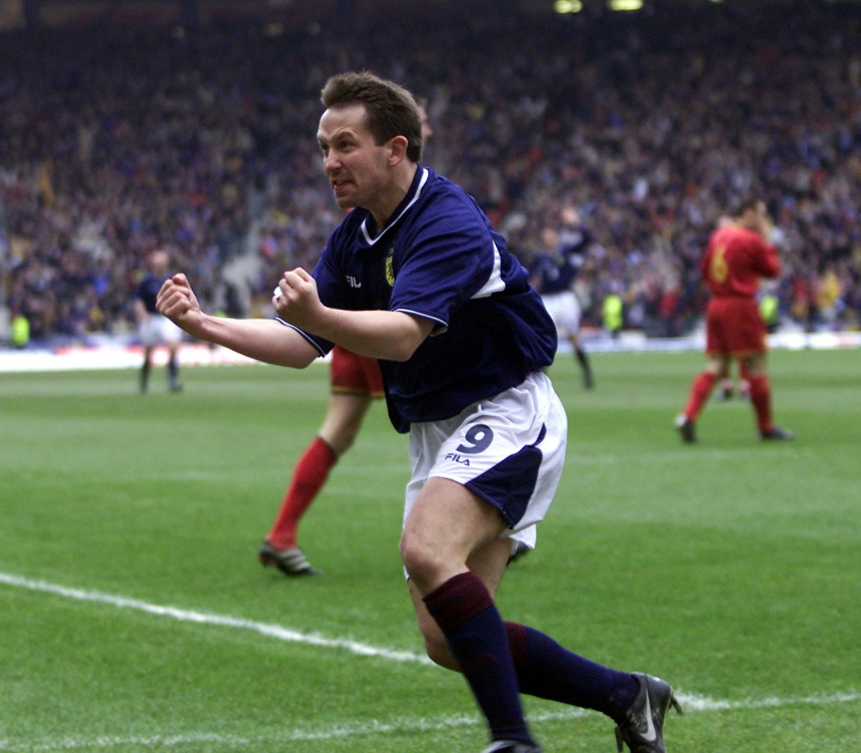 Billy Dodds celebrates after netting for Scotland against Belgium.
