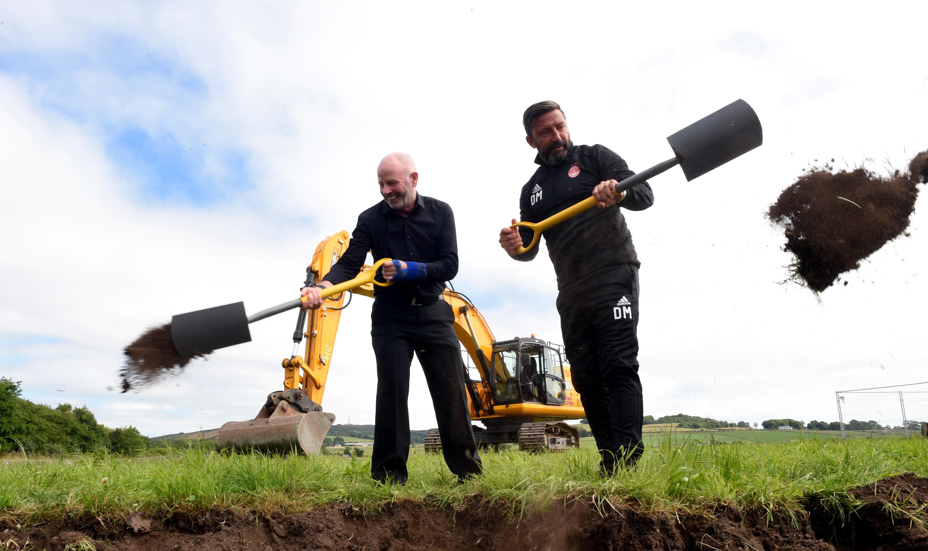 Stewart Milne and Derek McInnes start work on the construction of the new Dons stadium in September of last year