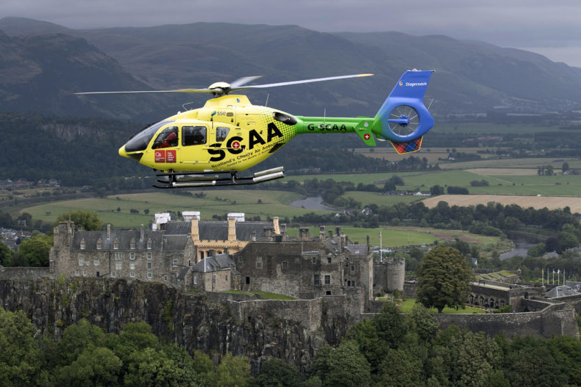 'Helimed 76' is pictured flying over Stirling Castle