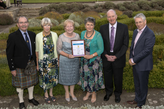 Forres in Bloom volunteers receive their award.
