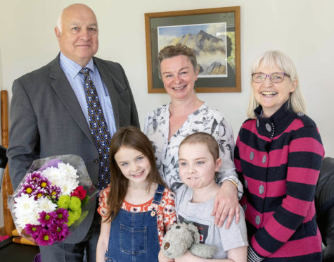 Councillor Bill Lobban with Lorna Cottam, Councillor Muriel Cockburn and front Della and Tavish.