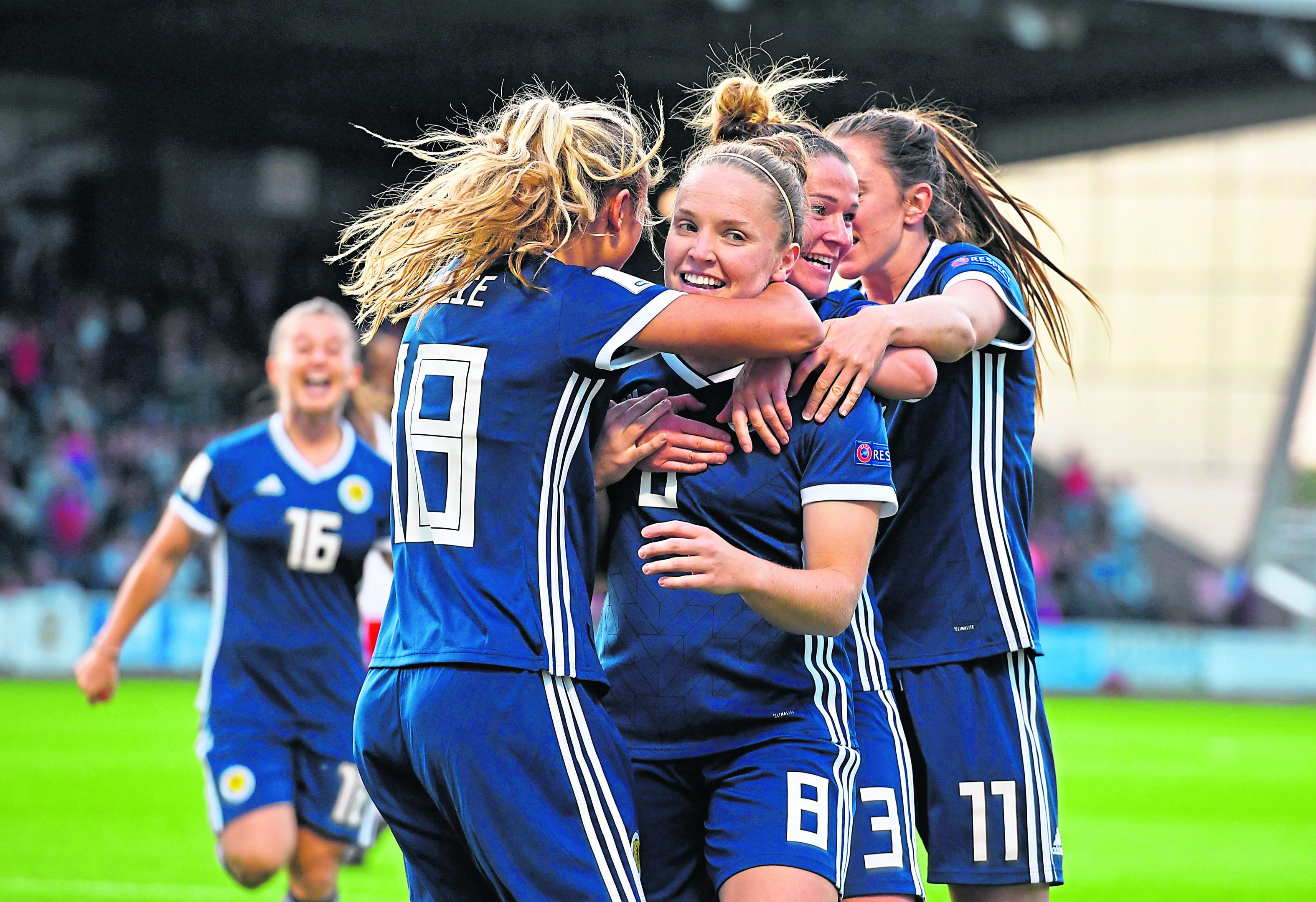 Scotland celebrate a Kim Little goal.