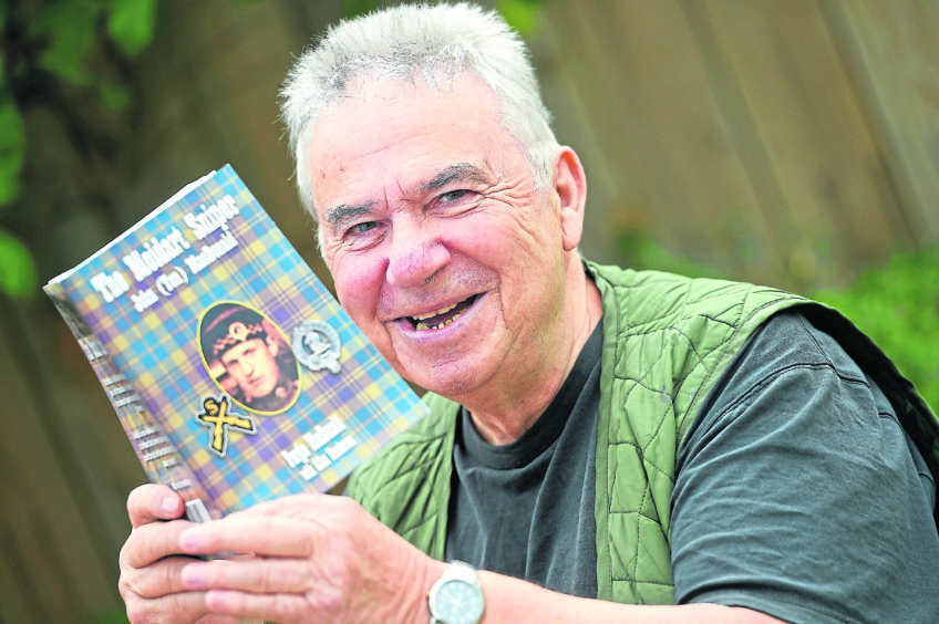 Fergie MacDonald  with the book about his father.
