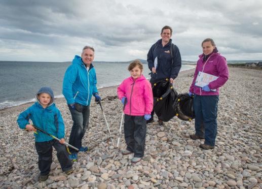 Picture: L to R - Ewan Moxon (volunteer) Richard Lochhead Ellie Moxon, Calum Brown (Head of Conservation Scotland at Marine Conservation Society and mum Alicia Moxon.