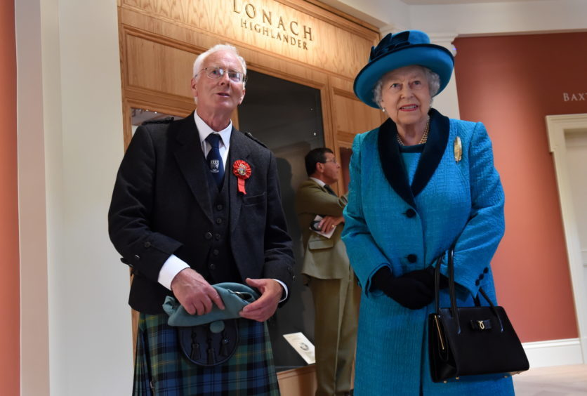 Braemar Gathering 2018, at The Princess Royal and Duke of Fife Memorial Park in Braemar. The Queen has officially opened a new Highland Games centre - named after her son the Duke of Rothesay. Picture of the Queen being shown around the new pavilion by David Geddes (Braemar Royal Highland Society president).  Picture by KENNY ELRICK     01/09/2018