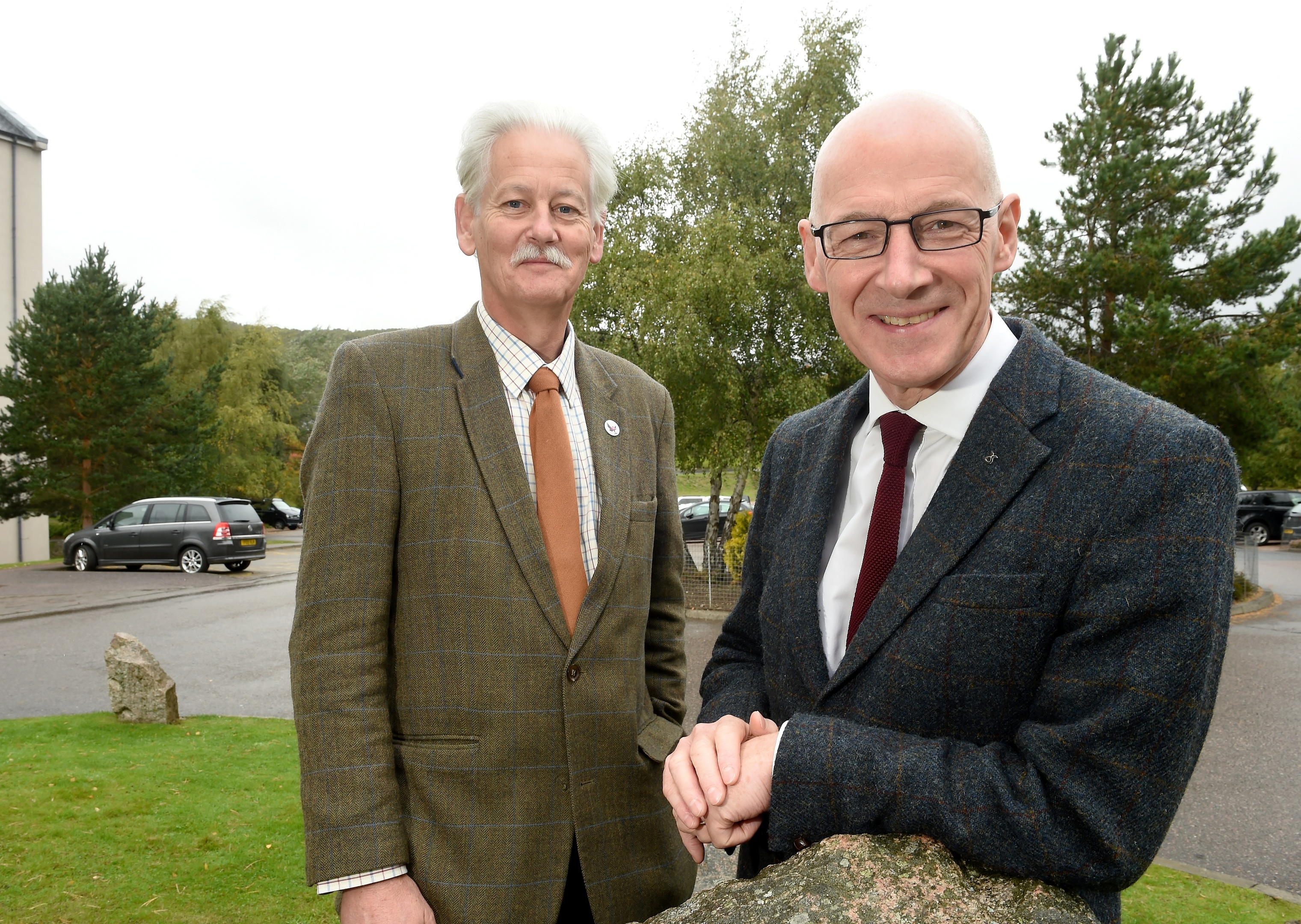 Deputy First Minister John Swinney with Peter Argyle, Convener of the Cairngorms National Park Authority outside the conference at Aviemore. Picture by Sandy McCook