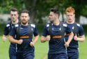 Ryan Dow (second left) and Greg Morrison (far right) during training at Ross County.