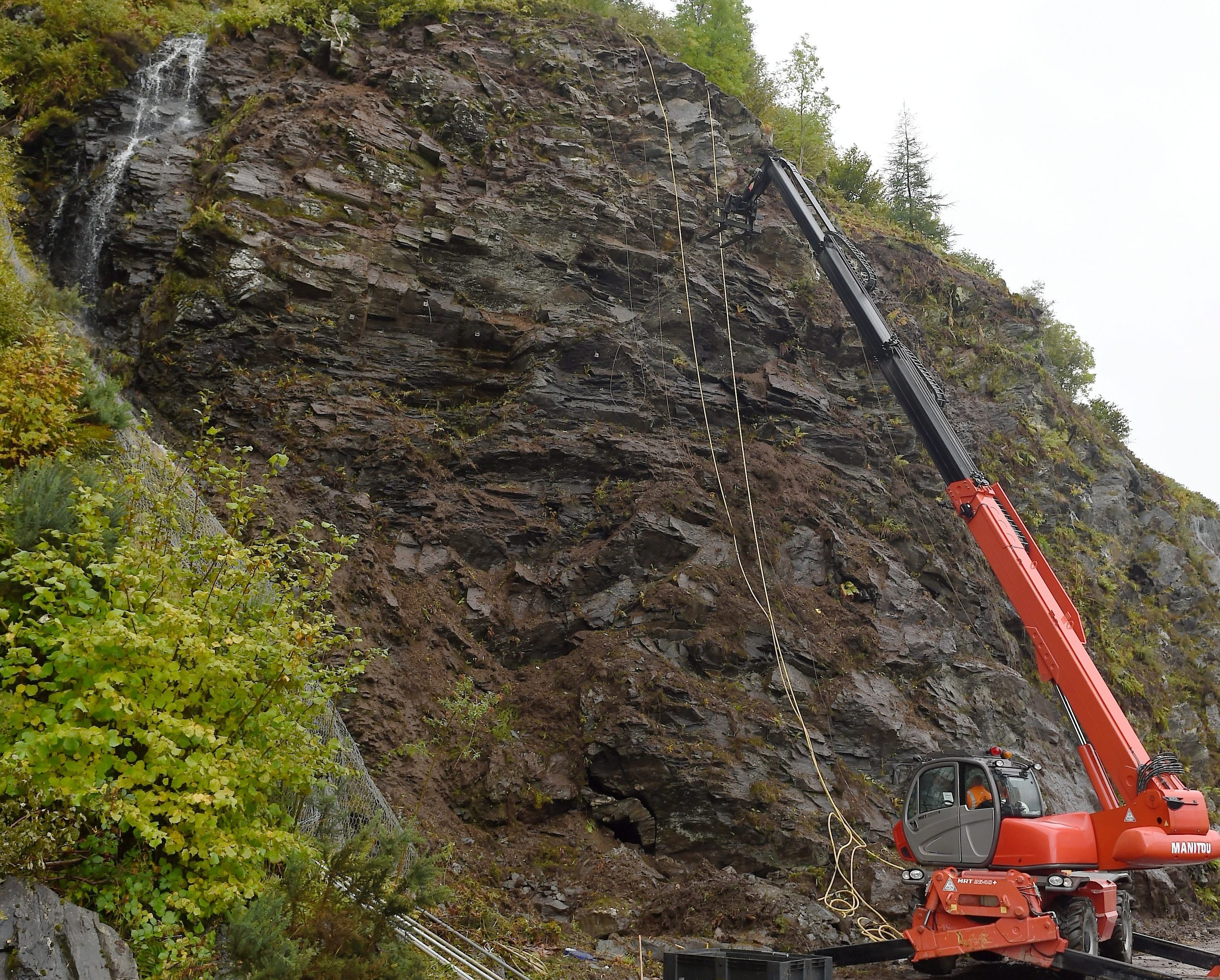 Engineers work high above the road as stabilising of rock and the installation of netting takes place above the A890 between Stromferry and Attadale.