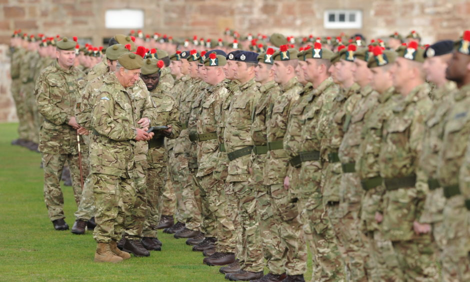 The Duke of Rothesay presenting 3 Scots soldiers with medals to commemorate their tour of Iraq at Fort George.