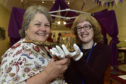 Councillor Anne Stirling (left) and Fiona Slattery Clark, museums development co-ordinator examine a pipe that was made and smoked by Queen Victoria's servant John Brown at Balmoral.