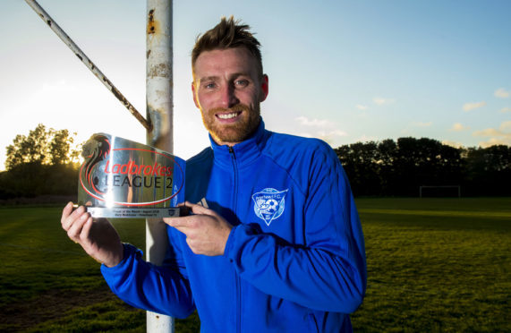 Peterhead forward Rory McAllister with his Ladbrokes League 2 player of the month award for August.
