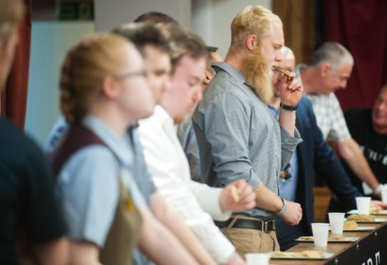 Photos of spirit of speyside festival at Elgin town hall. In photo winner of the oat cake eating compatition, Jasper EpsomPhoto byMichael Traill9 South RoadRhynieHuntlyAB54 4GAContact numbersMob07739 38 4792
