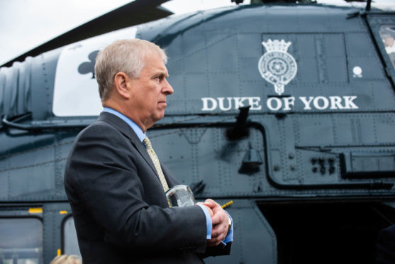 Prince Andrew visits Moryvia to present them with an award and name a helicopter.