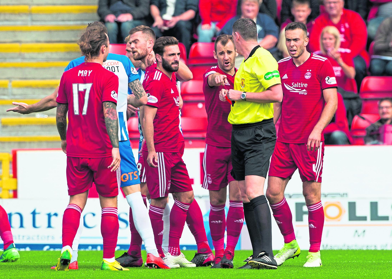 Aberdeen's Michael Devlin (L) is sent off by referee Craig Thomson.