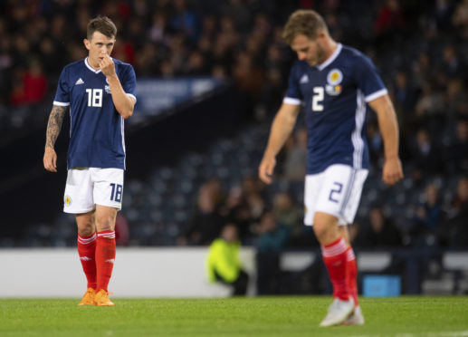 Ryan Jack (left) and Ryan Fraser reflect on Scotland's 4-0 defeat.