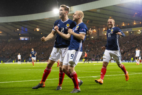 Steven Naismith celebrates with Stephen O'Donnell and Johnny Russell after giving Scotland the lead against Albania.