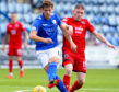 Callum Semple in action for Queen of the South against Ross County.