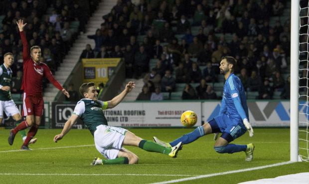 Aberdeen's Joe Lewis saves an attempt from Hibernian's Paul Hanlon.