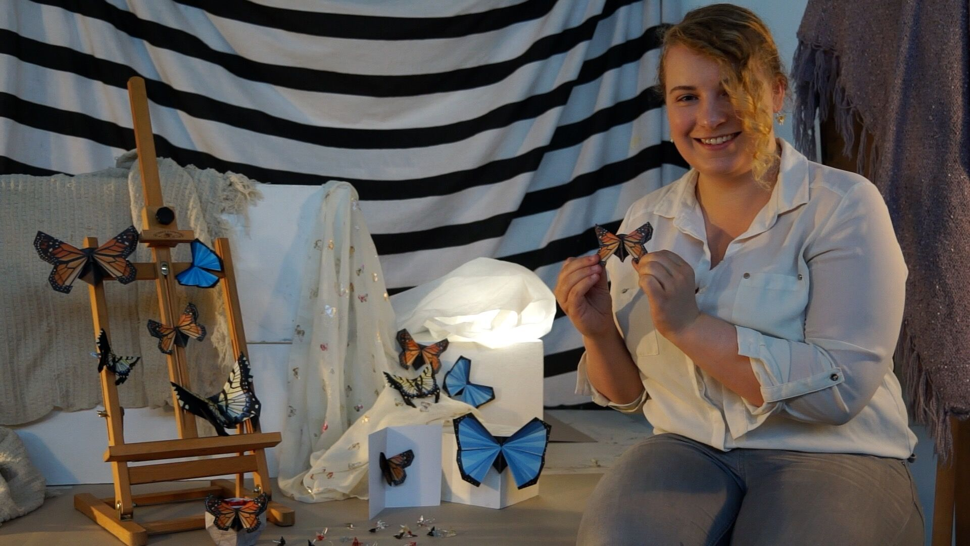 Student Cari Watterton with her butterfly craft kits which she hopes will raise money for conservation.