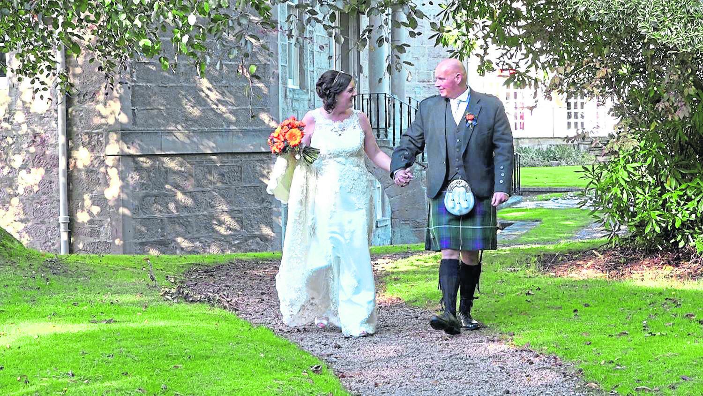 Newlyweds Sheree and James MacDonald take a stroll outside Nairn's Newton Hotel.