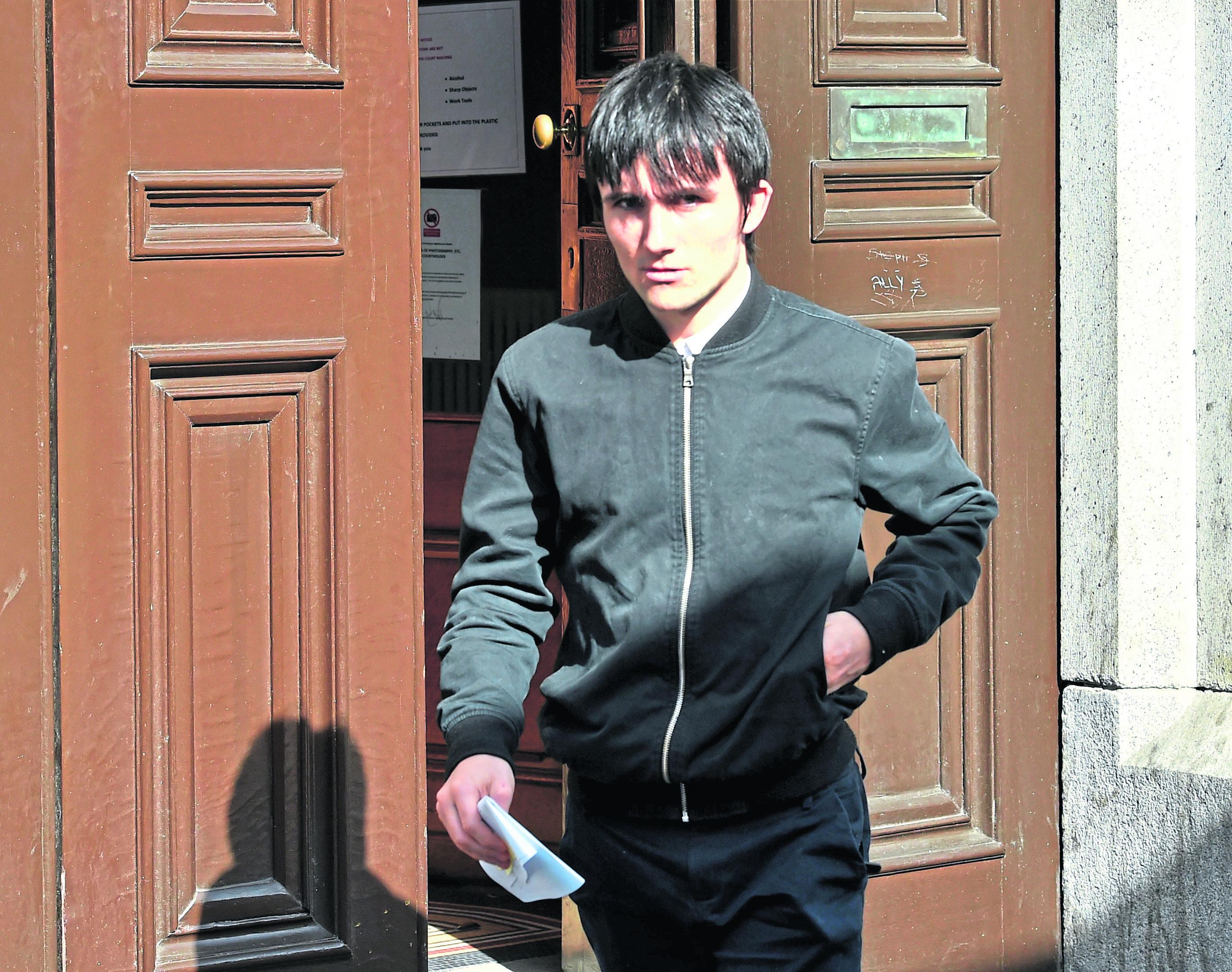 Dean Mutch leaving court
