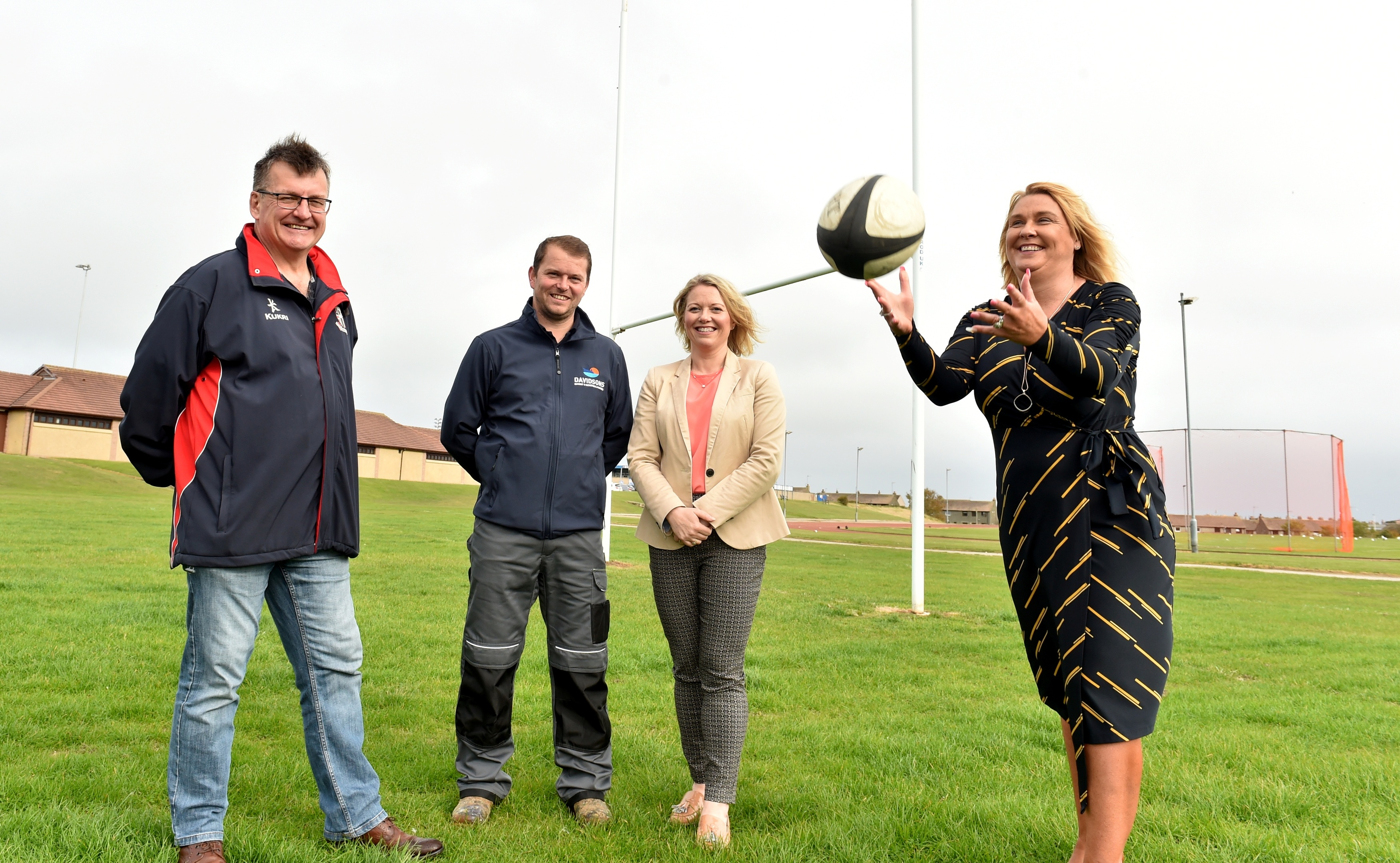 Alexander Davidson and Nicola Harris (centre) with Neil Davidson, secretary of Peterhead Rugby Club (left) and Councillor Dianne Beagrie.