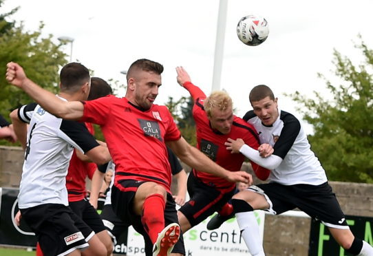 Chris Angus (centre) is confident Locos can deal a double knockout blow to Fraserburgh.